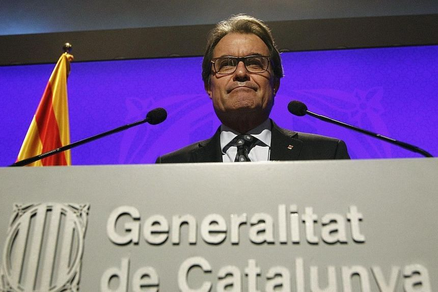 Catalonia's leader vowed Wednesday that a symbolic independence vote banned by the Spanish government will go ahead on November 9, setting the stage for a constitutional conflict unprecedented in post-Franco Spain. -- PHOTO: AFP