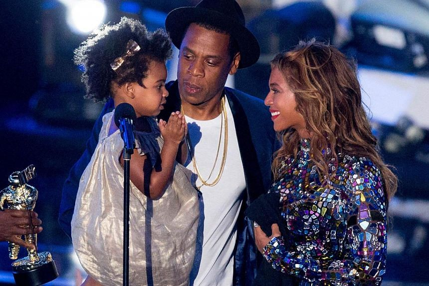 Rapper Jay Z and Beyonce with daughter Blue Ivy Carter onstage during the 2014 MTV Video Music Awards at The Forum in Inglewood, California on Aug 24, 2014. -- PHOTO: AFP