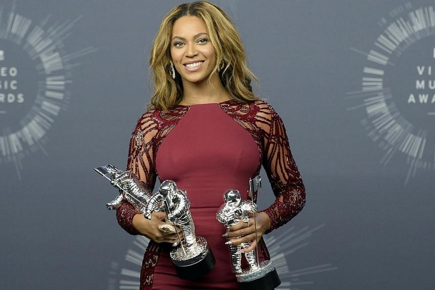Beyonce poses backstage with three of her four awards during the 2014 MTV Video Music Awards in Inglewood, California on Aug 24, 2014. -- PHOTO: REUTERS