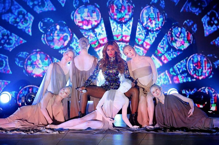 Beyonce (centre) performs onstage during the 2014 MTV Video Music Awards at The Forum in Inglewood, California on Aug 24, 2014. -- PHOTO: AFP