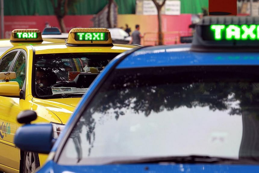 Taxis at Plaza Singapura shopping mall in 2013. -- PHOTO: ST FILE