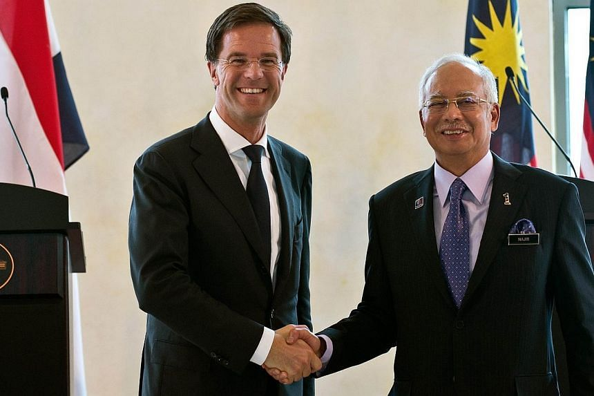 Malaysia's Prime Minister Najib Razak (right) with the Netherlands Prime Minister Mark Rutte at the end of a joint press conference at the prime minister's office in Putrajaya on Nov 5, 2014. Mr Rutte is an one-day official visit to Malaysia. -- PHOT