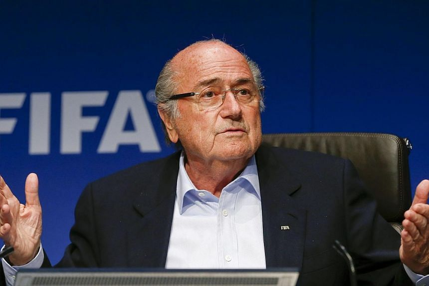 Police in riot gear were deployed at a university in Zurich as protesters tried to force their way into a room where Fifa president Sepp Blatter was giving a lecture. -- PHOTO: REUTERS