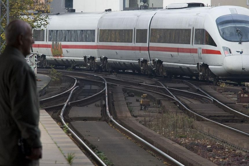A Deutsche Bahn (DB) Inter-city express train ( ICE ) arrives at the Friedrichstrasse station in downtown Berlin on Nov 5, 2014, on the start of national railway operator drivers' longest strike in 20 years.German train drivers began their long