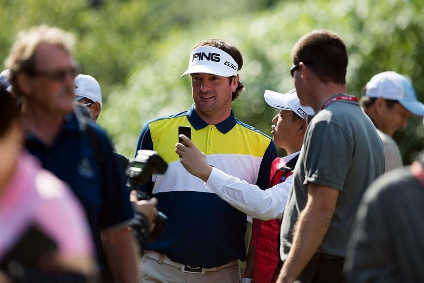 Bubba Watson of the US (centre) and a fan takes a selfie during the Pro-Am event for the WGC-HSBC Champions golf tournament in Shanghai on Nov 5, 2014.Double US Masters champion Bubba Watson turned 36 on Wednesday and said he needs to turn over