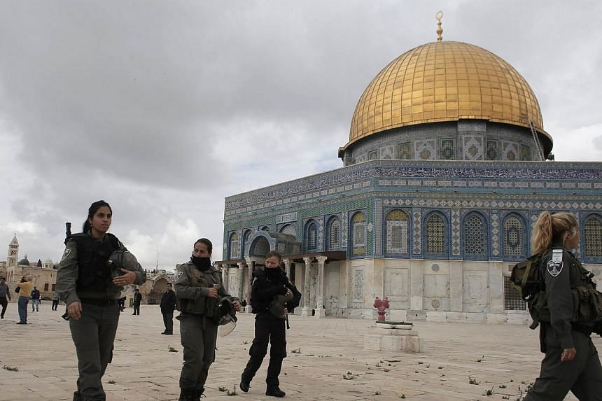 Israeli security forces walk near Jerusalem's Dome of the Rock mosque in the Al-Aqsa mosque compound, the third holiest site in Islam but also the most sacred place in Judaism on Nov 5, 2014. Jordan on Wednesday recalled its ambassador to Israel