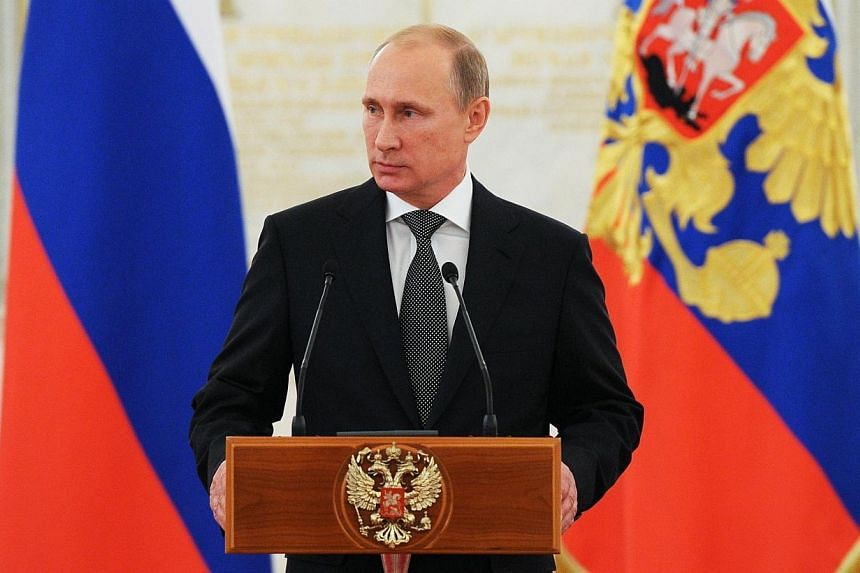 For a second year in a row, Russian President Vladimir Putin has beaten Barack Obama to the title of world's most powerful leader as ranked by Forbes. -- PHOTO: AFP