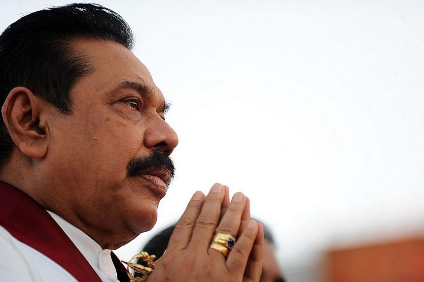 Sri Lanka President Mahinda Rajapakse praying during a religious ceremony at a 76 million dollar oil tank farm at the southern deep sea port of Hambantota on June 22, 2014. Sri Lanka's president has asked the top court to rule on whether he