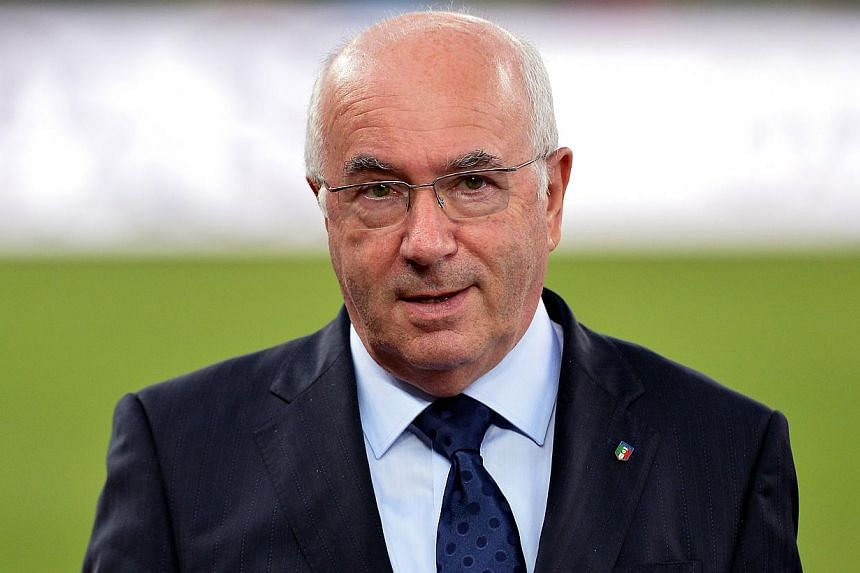 Italian football federation (FIGC) president Carlo Tavecchio has been barred from holding any position with world governing body Fifa for six months over an alleged racist comment he made in August. -- PHOTO: AFP