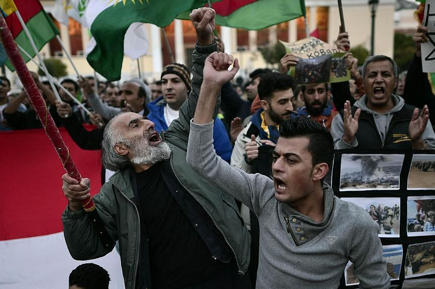 Kurds demonstrating in Athens on Saturday. Recent media reports suggest that citizens of Greece and Turkey have joined the YPG. -- PHOTO: AFP