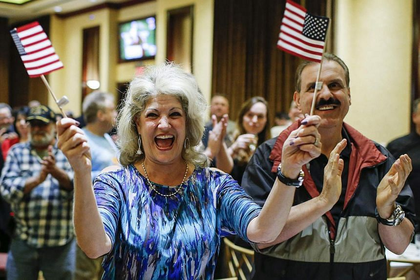 Supporters of Republican Michael Grimm celebrate after he was re-elected in the midterm elections in Staten Island, New York, on Nov 4, 2014. -- PHOTO: REUTERS