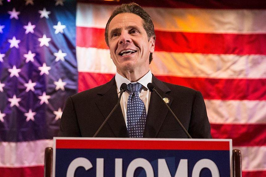 New York's Democratic Governor Andrew Cuomo has won re-election, CNN projected, defeating Republican Rob Astorino in the solidly Democratic state. -- PHOTO: AFP