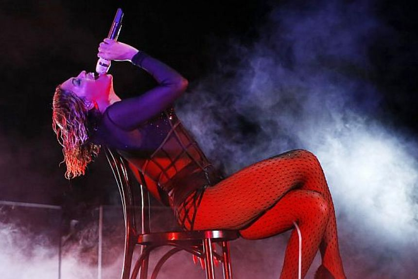 Beyonce performs Drunk In Love at the 56th annual Grammy Awards in Los Angeles, California in this file photo taken Jan 26, 2014. Beyonce is the highest-paid woman in music, with estimated earnings of US$115 million, more than double what she pulled