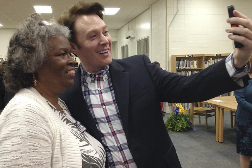 "Democratic nominee Clay Aiken taking a picture with a constituent after a campaign forum in Cary, North Carolina in this April 28, 2014 file photo. The former ""American Idol"" hopeful Clay Aiken lost out again, after coming in second on the US te"