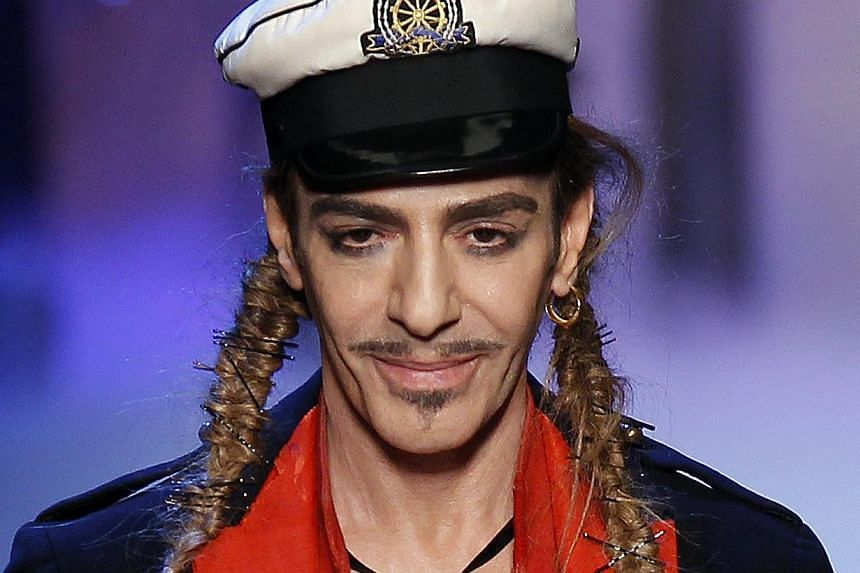 British designer John Galliano appears at the end of his Spring/Summer 2011 women's collection during Paris Fashion Week in this Oct 1, 2010 file photo. Galliano - sacked three years ago by fashion house Dior over a drunken anti-Semitic rant in a Par