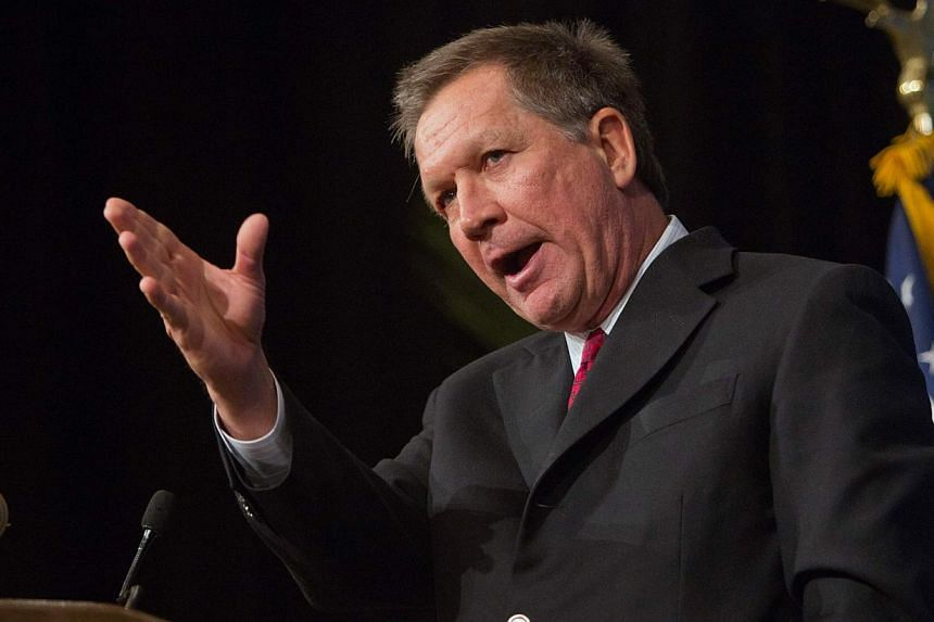 Ohio Republican Governor John Kasich has won re-election, CNN projected on Tuesday, beating Democratic challenger Ed FitzGerald in the electoral swing state. -- PHOTO: REUTERS