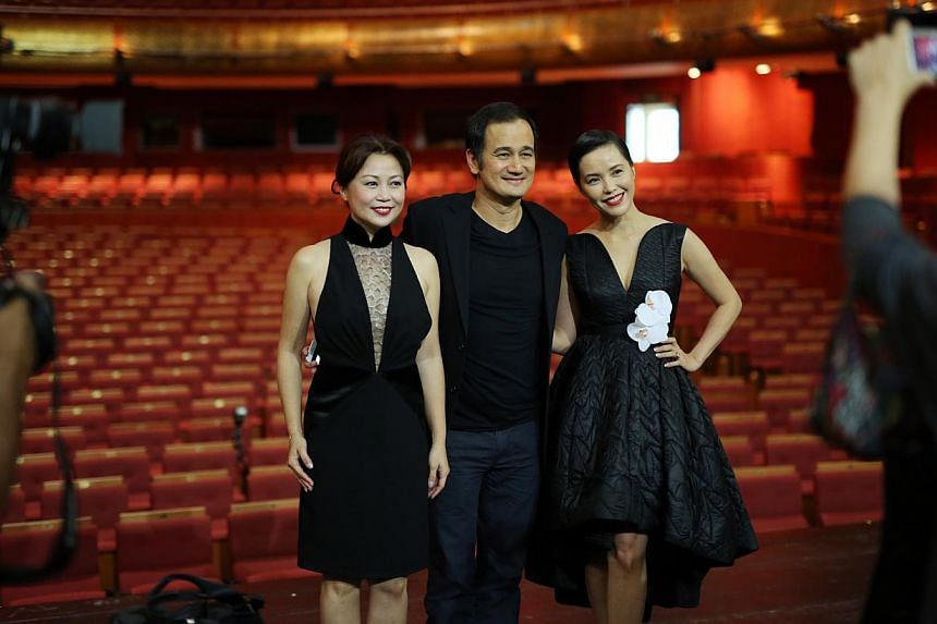 (From left) Xiang Yun, Gurmit Singh andZoe Tay were among29 arts and entertainment stars who came together for a photo shoot for an upcoming book tentatively titled Living The Singapore Story: 1965-2015. -- ST PHOTO: ONG WEE JIN