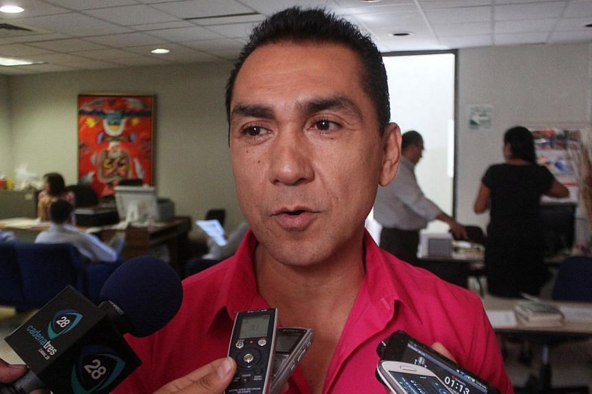 Fugitive former mayor Jose Luis Abarca speaks to the media in Chilpancingo in this October 29, 2013 file photo.Mexican police on Tuesday detained a fugitive former mayor and his wife accused of ordering a deadly police attack that left 43 stude
