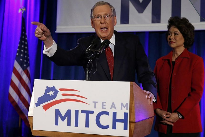 US Senate Minority Leader Mitch McConnell addresses supporters while accompanied by his wife, former United States Secretary of Labor Elaine Chao, at his midterm election night victory rally in Louisville, Kentucky, on Nov 4, 2014. -- PHOTO: REUTERS