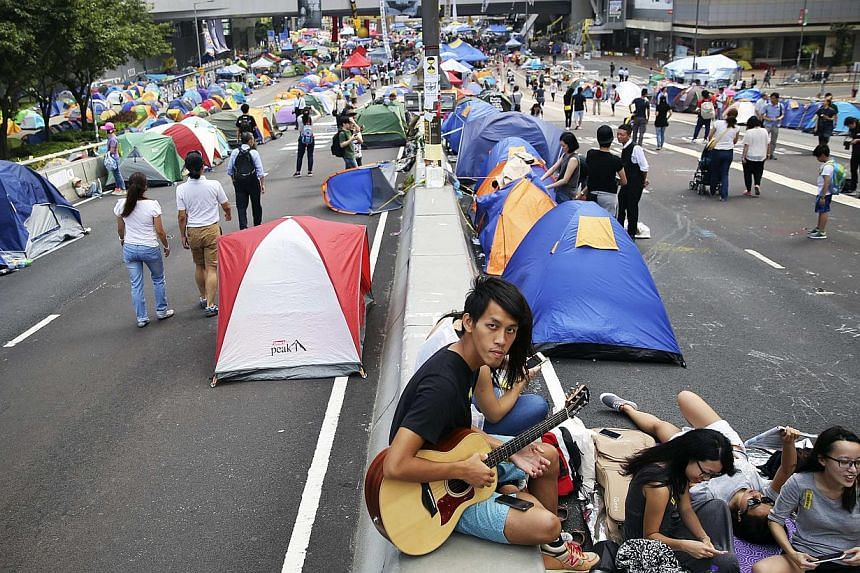 Pro-democracy protesters sing in the part of Hong Kong's financial central district they are occupying on Nov 2, 2014. -- PHOTO: REUTERS