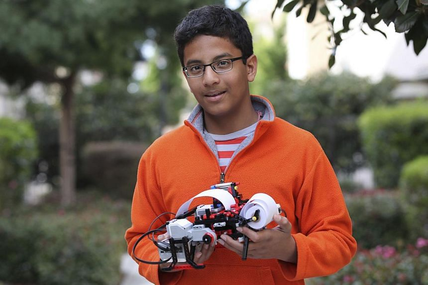 Shubham Banerjee, founder of Braigo Labs, holds a printer in Palo Alto, California, in this 2014 handout photo provided by Braigo Labs.Banerjee was 12 years old when he closed an early-stage funding round with Intel Capital, the company's ventu