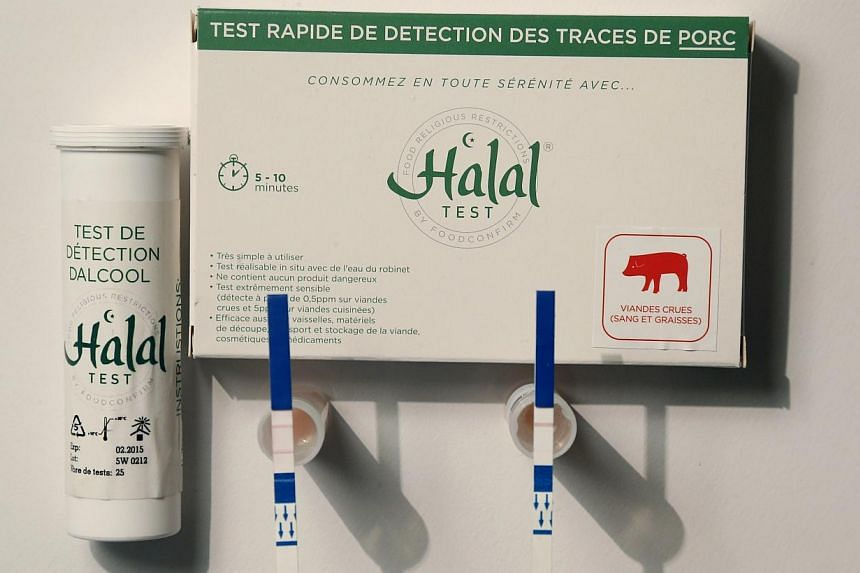 An illustration picture shows a kit to test for the presence of pork in food for use by Muslims, with small test tubes in which a food sample is mixed with warm water and test strips, at Capital Biotech's offices in Asnieres sur Seine on Oct 21, 2014