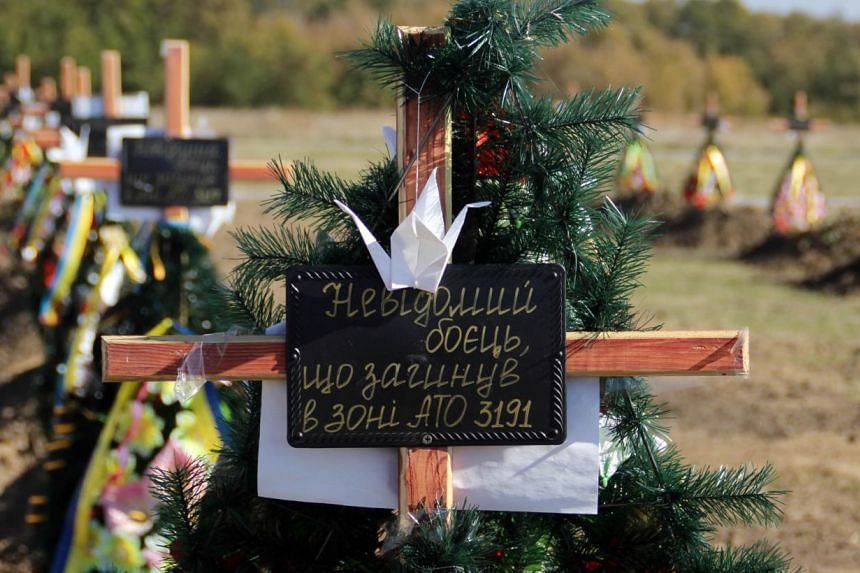 A picture taken on October 12, 2014, showing the Kushugumske cemetery in the suburbs of Zaporizhia, south-eastern Ukraine, where the remains of unidentified Ukrainian soldiers killed in fighting against pro-Russia separatists are buried. Before the w