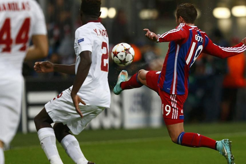 Bayern Munich's Mario Goetze (right) scores a goal against AS Roma during their Champions League Group E second leg match in Munich on Nov 5, 2014. -- PHOTO: REUTERS