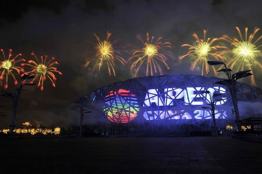 """Fireworks explode over a screen displaying the APEC logo on the National Stadium, or the """"Bird's Nest"""", during a rehearsal for the opening of the APEC Summit in Beijing on Nov 4, 2014.The Asia-Pacific Economic Cooperation (Apec) is a forum that"""