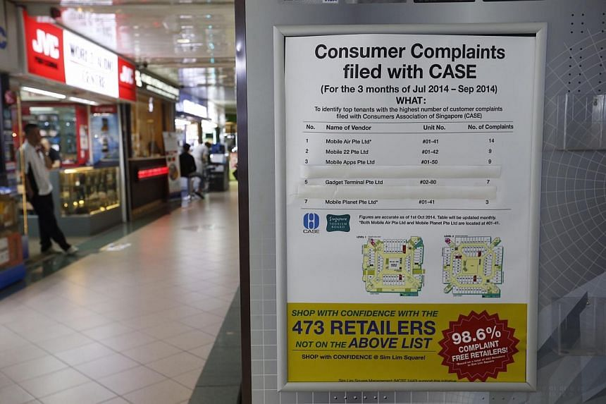 A notice on the second level listing names of shops that were complained against in Sim Lim Square on Nov 6, 2014.-- ST PHOTO: KEVIN LIM