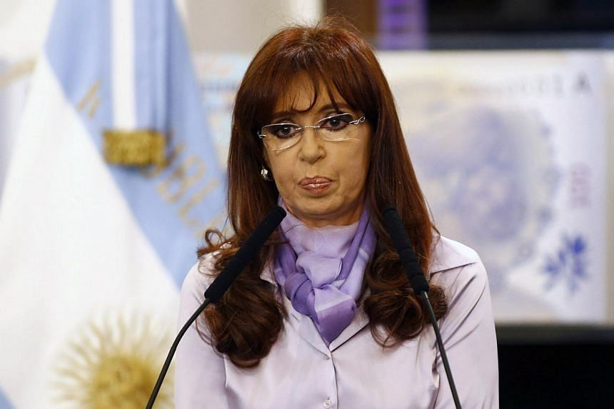 According to a government spokesman, Argentina's President Cristina Fernandez would definitely miss the next summit of leaders of the Group of 20 leading industrialised nations in Brisbane, Australia, on Nov 15 to Nov 16. -- PHOTO: REUTERS