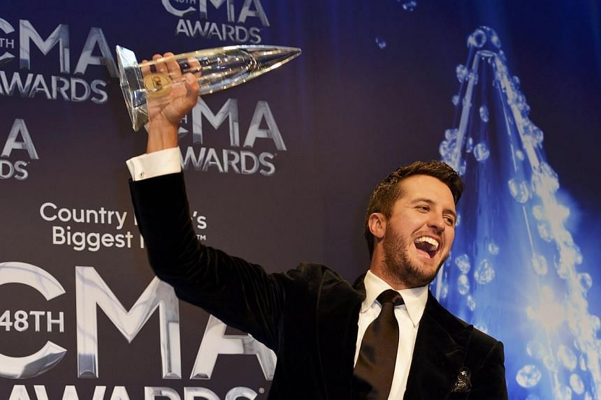 Luke Bryan poses with his Entertainer of the Year Award during the 48th Country Music Association Awards in Nashville, Tennessee on Nov 5, 2014. -- PHOTO: REUTERS
