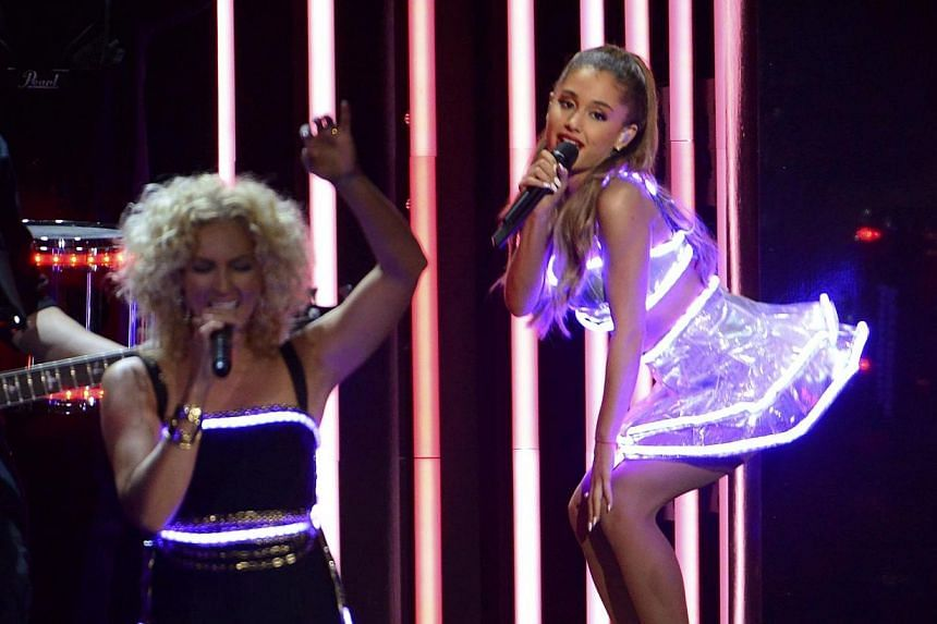 "Singer Ariana Grande (right) performs ""Bang Bang"" with Little Big Town during the 48th Country Music Association Awards in Nashville, Tennessee on Nov 5, 2014. -- PHOTO: REUTERS"