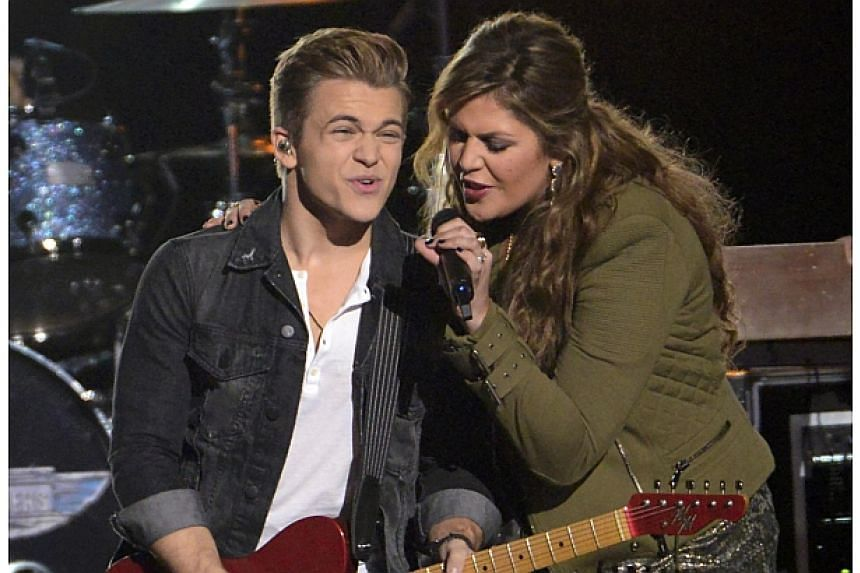 "Hunter Hayes and Hillary Scott perform ""Takin It to the Streets"" with The Doobie Brothers during the 48th Country Music Association Awards in Nashville, Tennessee on Nov 5, 2014. -- PHOTO: REUTERS"