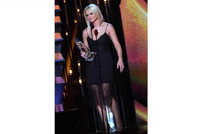 Miranda Lambert accepts the Female Vocalist of the Year Award during the 48th annual CMA Awards at the Bridgestone Arena on Nov 5, 2014 in Nashville, Tennessee. -- PHOTO: AFP
