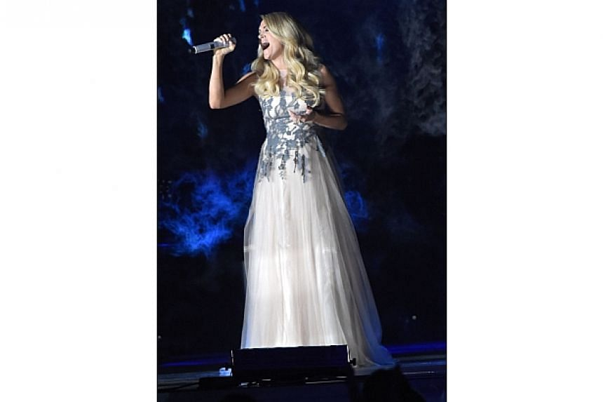 Carrie Underwood performs during the 48th annual CMA Awards at the Bridgestone Arena on Nov 5, 2014 in Nashville, Tennessee. -- PHOTO: AFP