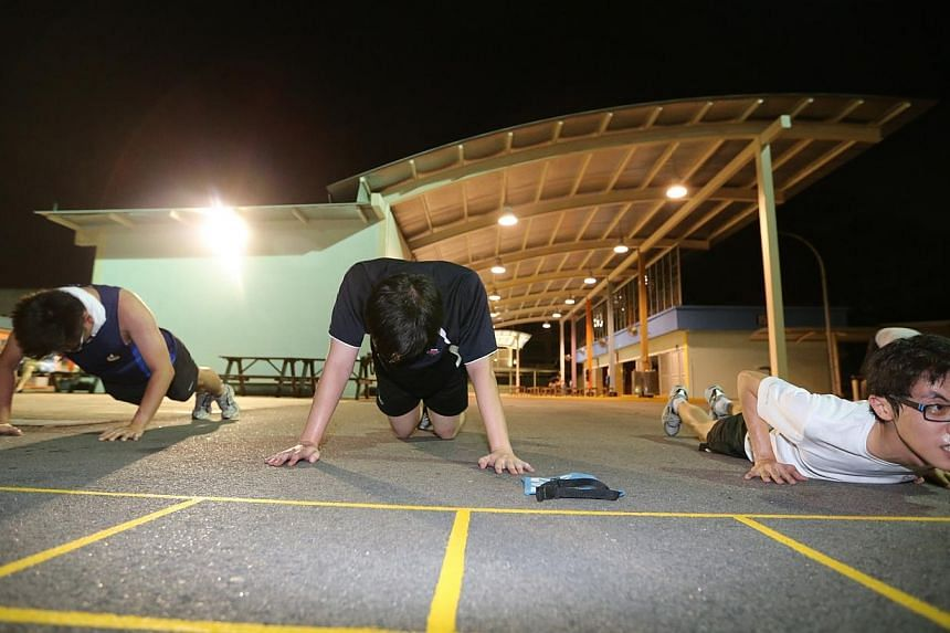 People doing push ups as part of IPPT Preparatory Training (IPT) programme in Maju Camp on Sept 8, 2014. -- PHOTO: ST FILE