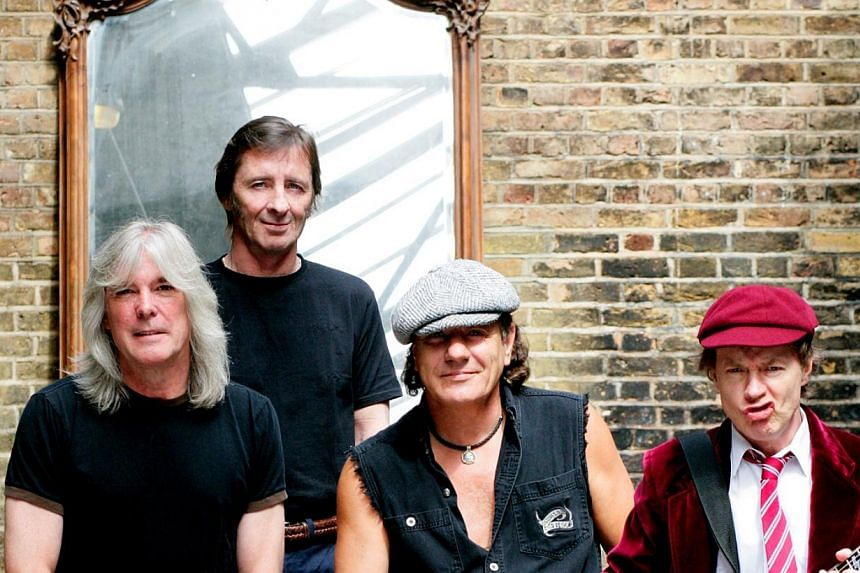 AC/DC drummer Phil Rudd (second from left) is seen here in a group photo of the band.-- PHOTO:SONY BMG