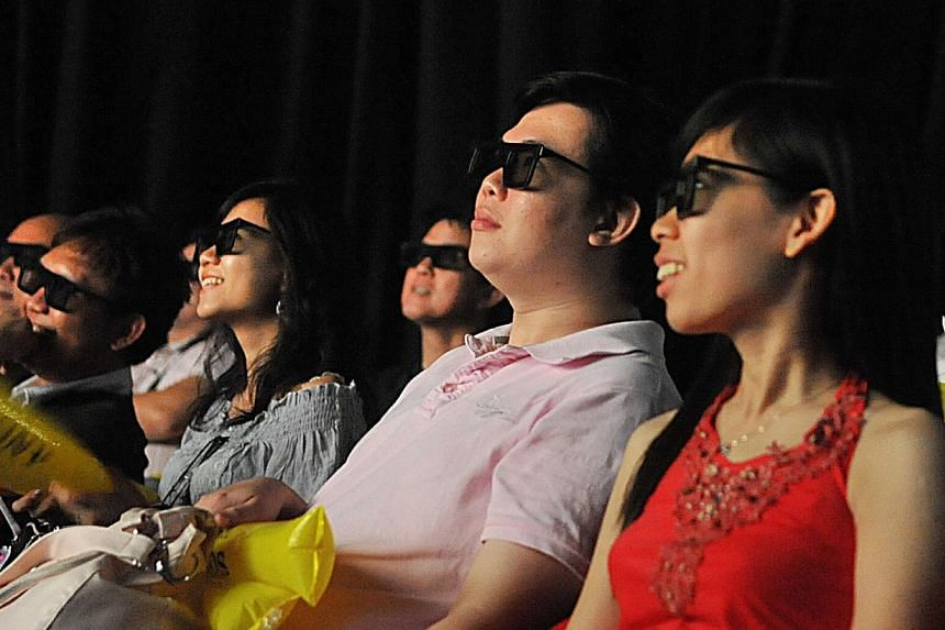 """A French health watchdog recommended Thursday that children under six be denied access to 3-D films, computers and video games, and that those up to 13 have """"moderate"""" access. -- PHOTO: ST FILE"""