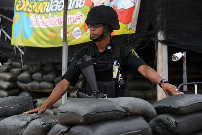 A member of Thailand's special police force mans his post at a checkpoint in Thailand's restive southern province of Narathiwat on Nov 4, 2014.Thai Prime Minister Prayuth Chan-ocha is ready to consider lifting martial law in some parts of the c