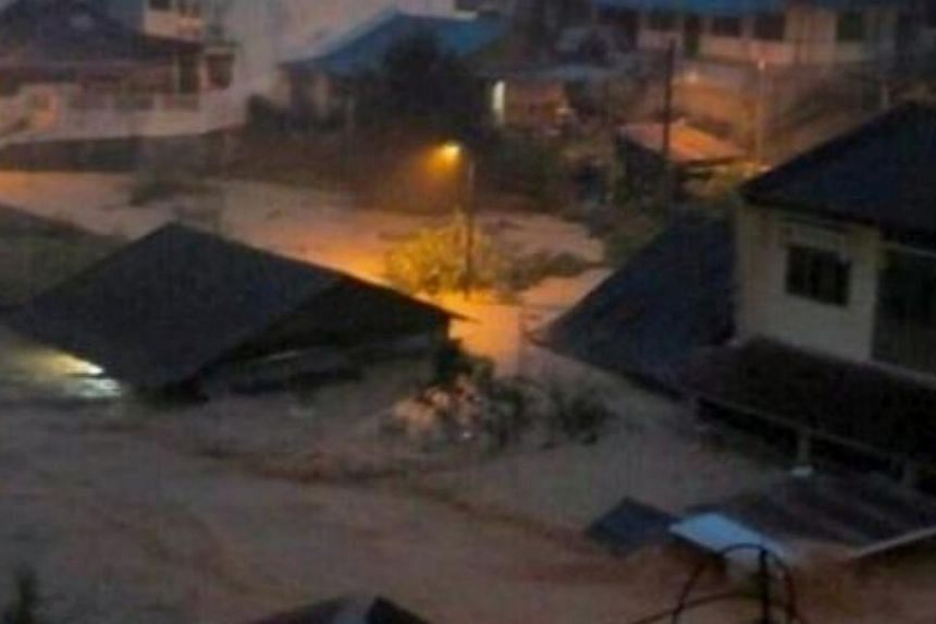 A picture making its rounds on Twitter showing flood waters almost reaching the roof of a low-level house.-- PHOTO: THE STAR/ASIA NEWS NETWORK