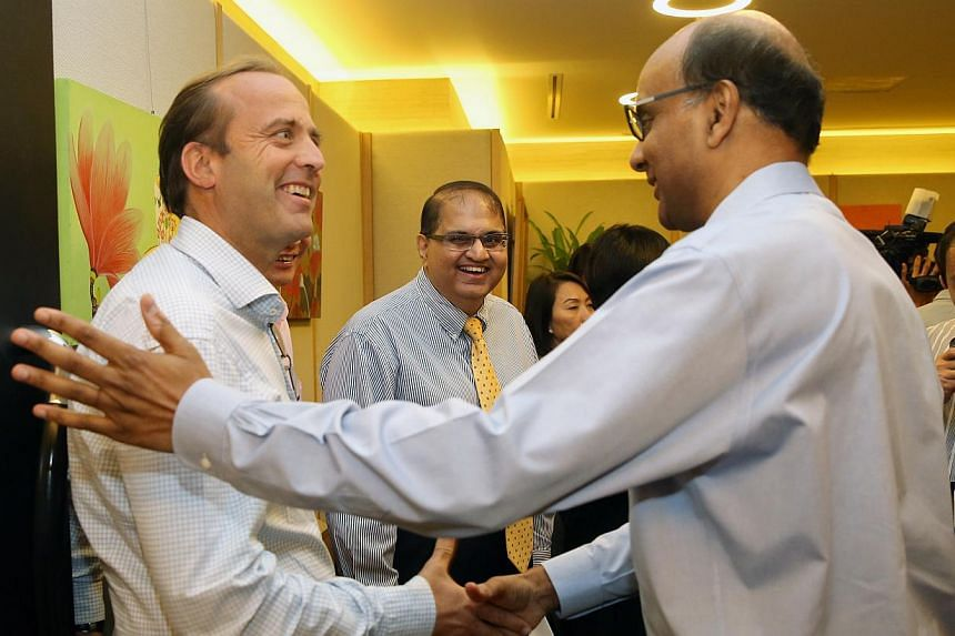 DPM Tharman with council members (from left) Oscar de Bok from DHL Supply Chain and Aziz Amirali Merchant from Keppel FELS.