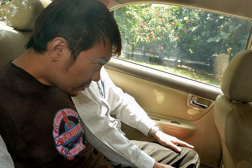 The former China tour guide embroiled in a tussle over the assets of a rich widow has been granted bail of $150,000, the court decided on Thursday. His passport has also been impounded. -- ST PHOTO:KUA CHEE SIONG