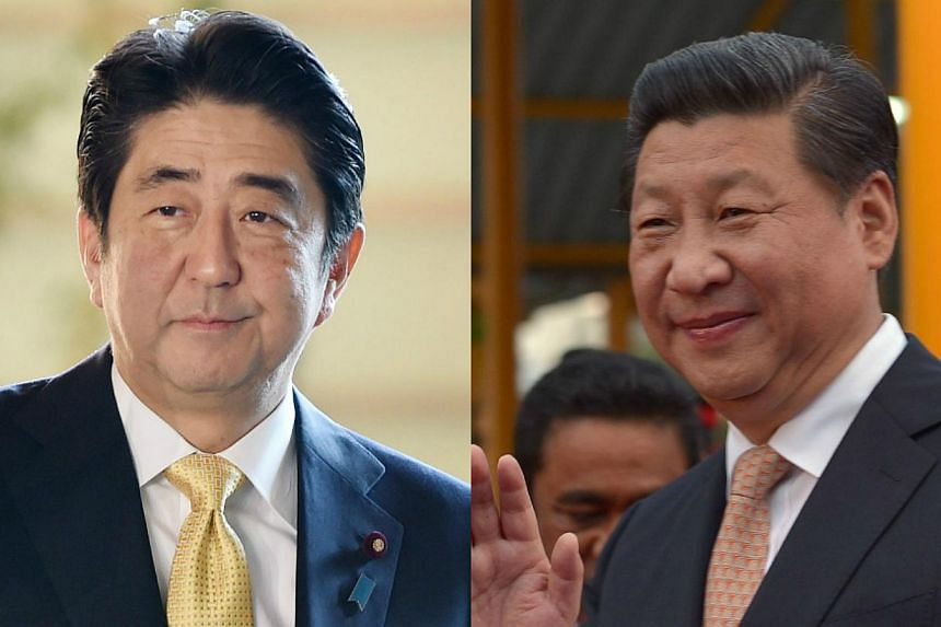 The Japanese and Chinese governments are making final arrangements for talks between Prime Minister Shinzo Abe (left) and Chinese President Xi Jinping (right), to be held on the sidelines of the upcoming Asia-Pacific Economic Cooperation forum in Bei