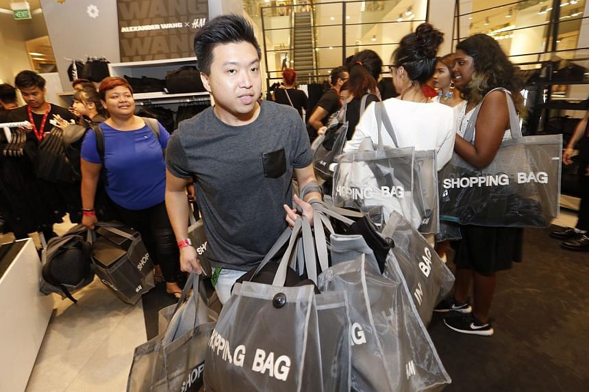 Shoppers browse through the new Alexander Wang collection at H&M. -- ST PHOTO: KEVIN LIM