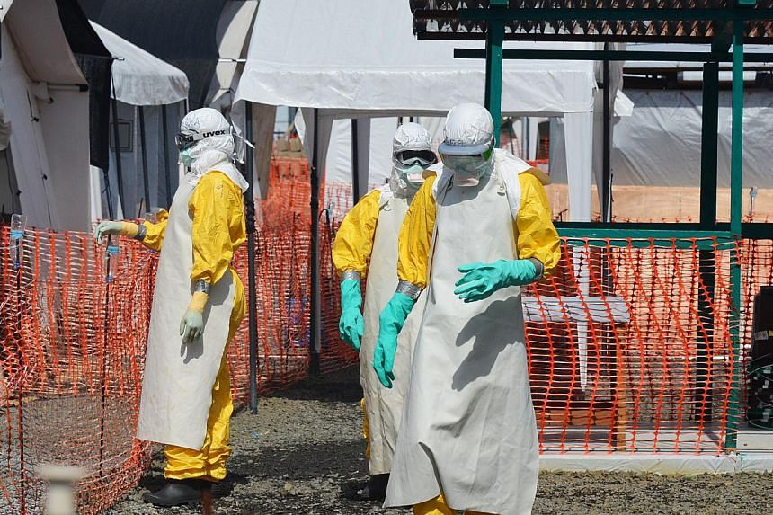 Health workers dressed in clothing to protect against Ebola at a clinic run by the non-governmental organisation Medecin Sans Frontieres - or Doctors Without Borders - in Monrovia on Nov 1, 2014. Doctors in Germany said on Wednesday a patient in