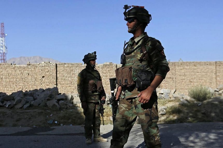 """Afghan security forces at the site of a suicide bomb attack in Kabul on Oct 2, 2014. Afghan troops are dying on the battlefield in unprecedented numbers after having taken over from Nato-led forces, and the death toll is """"not sustainable,"""" a top US c"""