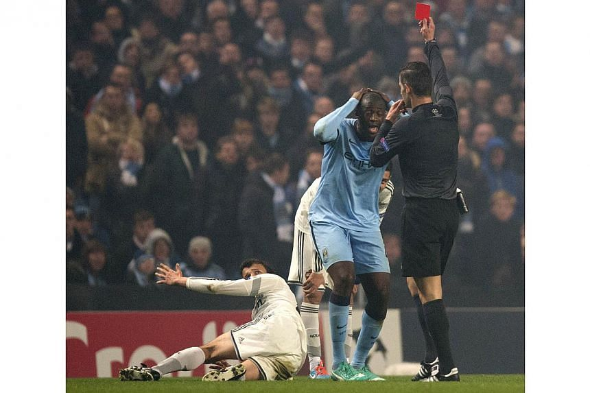 Toure was shown a straight red card for a petulant shove to the face of Eremenko. -- PHOTO: AFP