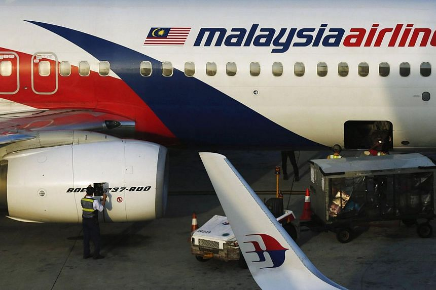 Minority shareholders in Malaysian Airline System Bhd (MAS) on Thursday backed a RM1.4 billion (S$542.6 million) bid by its majority owner, state fund Khazanah Nasional Bhd, to take the struggling carrier private. -- PHOTO: REUTERS