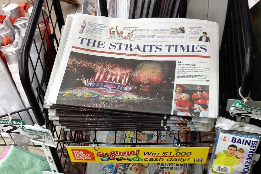 A rack displaying copies of The Straits Times, which is still the most-read English newspaper, according to this year's Nielsen Media Index Report. -- ST PHOTO: KEVIN LIM